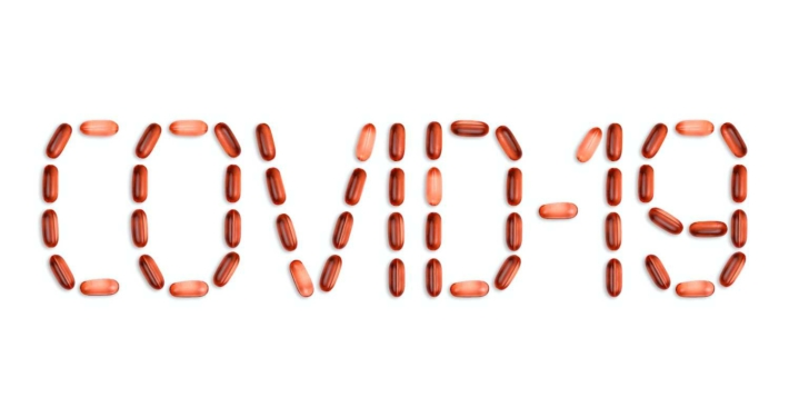 COVID-19 sign made with pills